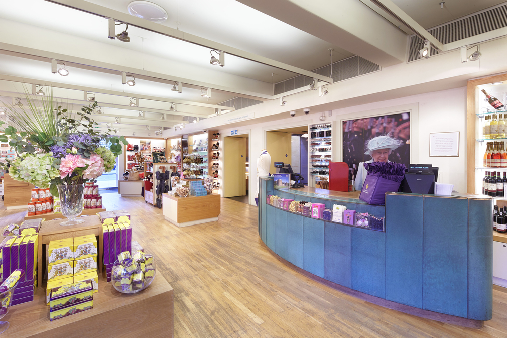 Till, shelves with retail stock and polished wooden floors of the shop