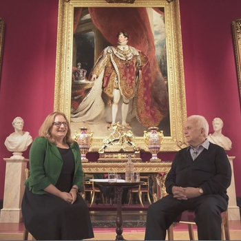 Andrew Davies and Kathryn Jones in conversation in front of portrait of George IV