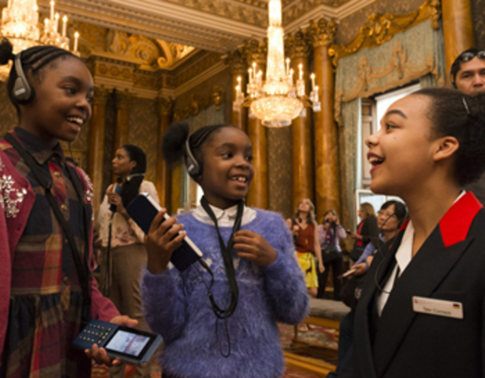 A Warden talking about the multimedia guide during the Summer Opening of Buckingham Palace